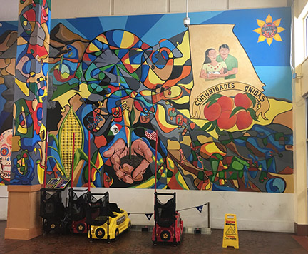 """comunidades unidas"" mural at another Latino ethnic mall in suburban Atlanta"