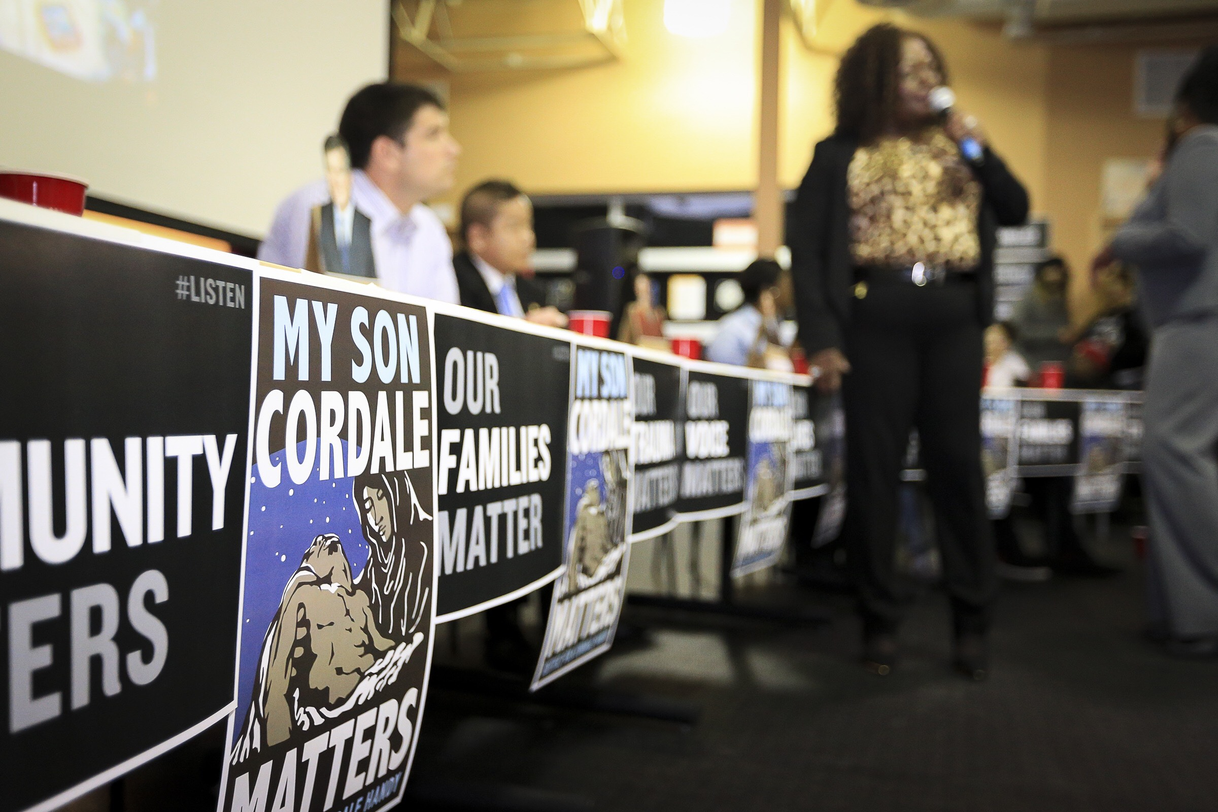 Posters by Leon Wang at a community meeting after the officer-involved killing of Cordale Handy in Saint Paul